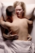 Naked young couple in bed