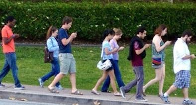 teen texting manhole